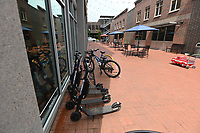 NWA Democrat-Gazette/SPENCER TIREY Goat Scooters, scooters that are rented by scanning a QR code, are seen by bike rack outside the Press Room, Wednesday July 10, 2019 in downtown Bentonville.