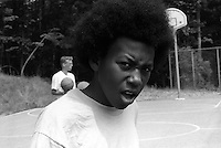 One of my photography students on the Basket ball court. Camp Mariah (Carey), Fresh Air Fund, Fishkill, New York Summer 1997