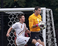 Harvard University goalkeeper Brett Conrad (1) grabs a corner kick before Boston College defender Matt Wendelken (8) can connect.Boston College (white) defeated Harvard University (crimson), 3-2, at Newton Campus Field, on October 22, 2013.