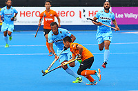 Faiz Jali of Malaysia and India's Sunil Sowmarpet compete for the ball during the Hockey World League Quarter-Final match between India and Malaysia at the Olympic Park, London, England on 22 June 2017. Photo by Steve McCarthy.
