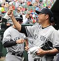 Hiroki Kuroda (Yankees),<br /> JULY 25, 2013 - MLB :<br /> Hiroki Kuroda of the New York Yankees gets a fist bump from his teammate during the Major League Baseball game against the Texas Rangers at Rangers Ballpark in Arlington in Arlington, Texas, United States. (Photo by AFLO)
