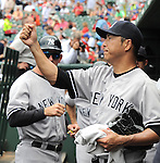 Hiroki Kuroda (Yankees),<br /> JULY 25, 2013 - MLB :<br /> Hiroki Kuroda of the New York Yankees gets a fist bump from his teammate during the Major League Baseball game against the Texas Rangers at Rangers Ballpark in Arlington in Arlington, Texas, United States. (Photo by AFLO)