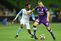 Melbourne, 23 April 2017 - BRUCE KAMAU (11) of Melbourne City and MARC WARREN (3) of the Glory fight for the ball in the Elimination Final 2 of the A-League between Melbourne City and Perth Glory at AAMI Park, Melbourne, Australia. Perth won 2-0. Photo Sydney Low/sydlow.com