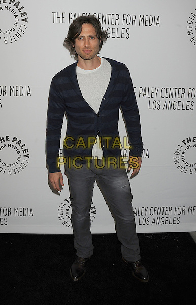 "BRAD FALCHUK.The PaleyFest for ""Glee"" at the Saban Theatre in The Paley Center for Media in Beverly Hills, California, USA..March 16th, 2011.full length grey gray black jeans denim white top cardigan .CAP/ROT/TM.© TM/Roth/Capital Pictures"