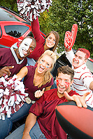 Series with college football fans tailgating and having fun before the game.