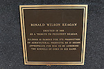 A plaque with a deleted apostrophe rests on the statue of Ronald Reagan outside his boyhood home in Dixon, Illinois on October 26, 2008.