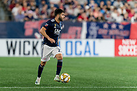 FOXBOROUGH, MA - SEPTEMBER 21: Carles Gil #22 of New England Revolution looks to pass during a game between Real Salt Lake and New England Revolution at Gillette Stadium on September 21, 2019 in Foxborough, Massachusetts.