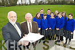 Cormac Bonner Principal of Milltown Secondary school and Eamon Fitzgerald Chairperson of the Board of Management look at the plans on the site where the new school will be built in Milltown with students l-r: Aisling Brennan, Adrian Murphy, Emily Cahill, Cathal O'Connor, Yvonne O'Shea, Siun Riordain, Niamh Ladden. Tara Piggot and Oonagh Kelliher ..