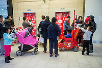 Crowds of last minute shoppers wait for elevators in the Queens Center mall in the borough of Queens in New York on Super Saturday, December 20, 2014. Super Saturday, the Saturday prior to Christmas was crowded with shoppers and is expected to generate more sales than Black Friday.  (© Richard B. Levine)