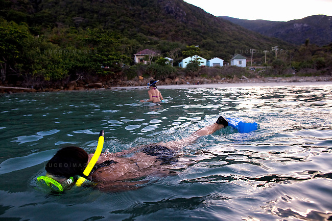 Phung Bui-Singer, 34, front, and Julia Le, 35, of San Jose, Calif., snorkel at Bai Nhat beach on Con Son Island, part of the Con Dao Islands.The 16 mountainous islands and islets are situated about 143 miles southeast of Ho Chi Minh City in Vietnam, in the South China. Photo taken Thursday, May 5, 2010...Kevin German / LUCEO For the New York Times