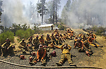 August 21, 2001 Coulterville, California  -- Creek Fire – Conservation Camp Fire Crew takes rest after cutting fire line.  The Creek Fire burned 11,500 acres between Highway 49 and Priest-Coulterville Road a few miles north of Coulterville, California.