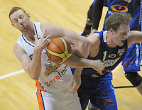 Gareth Dawson takes a rebound under pressure from Rick Rickert during the national basketball league match between Wellington Saints and Southland Sharks at the TSB Bank Arena, Wellington, New Zealand on Friday, 5 July 2013. Photo: Dave Lintott / lintottphoto.co.nz