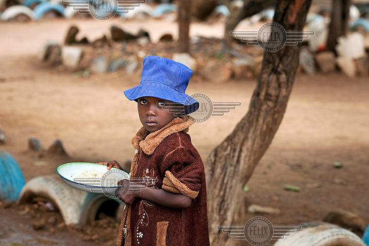 A girl with her lunch at Zvehuru primary school.