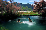 Couple soaking in the hot spring at Frog Ranch