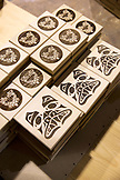 CANADA, Vancouver, British Columbia, laser carved wooden boxes at Spirit Works Limited in North Vancouver, an  aboriginal owned and operated company