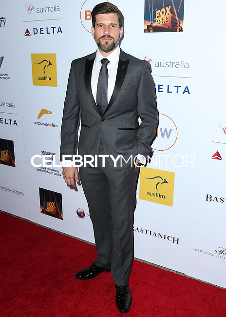 SANTA MONICA, CA, USA - OCTOBER 26: Osher Gunsberg arrives at the 3rd Annual Australians in Film Awards Benefit Gala held at the Starlight Ballroom at Fairmont Miramar Hotel & Bungalows on October 26, 2014 in Santa Monica, California, United States. (Photo by Xavier Collin/Celebrity Monitor)