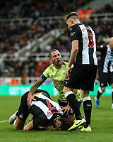 9th November 2019; St James Park, Newcastle, Tyne and Wear, England; English Premier League Football, Newcastle United versus AFC Bournemouth; Andy Carroll of Newcastle United holds his head after his is kicked in the head by Steve Cook of AFC Bournemouth who consoles him - Strictly Editorial Use Only. No use with unauthorized audio, video, data, fixture lists, club/league logos or 'live' services. Online in-match use limited to 120 images, no video emulation. No use in betting, games or single club/league/player publications
