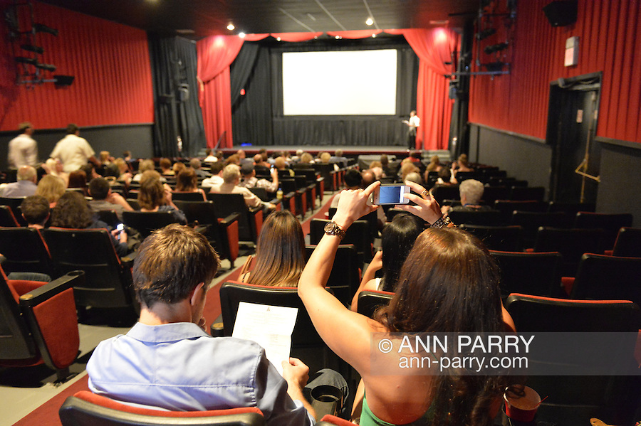 Bellmore, New York, United States. July 10, 2015. Before the screening of the short film HALINA, a woman takes cell phone photo, during LIIFE, the Long Island International Film Expo. LIIFE events, including screenings, panels, and ceremonies, span from July 8 through July 16.