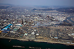 March 13, 2011, Ishonomaki, Japan - Port facility and houses of Ishinomaki, foreground, are obliterated on on Sunday, March 13, 2011, two days after a 10-meter tsunami swallowed this northeastern Japanese coastal town. A powerful earthquake with a magnitude 9.0 jolted Japans northeastern prefectures, wreaking havoc on otherwise beautiful coastal towns and farmlands. The death toll from the nation's worst and the world's fourth worst quake could rise above 10,000. (Photo by Yoichi Tsukioka/AFLO) [2570] -mis-