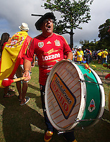 A Spain supporter bangs his drum outside Arena Fonte Nova, Salvador