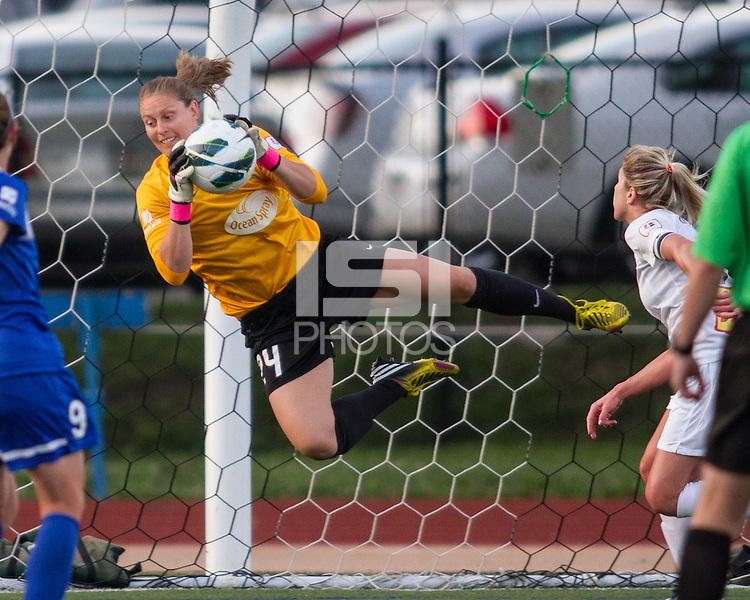 In a National Women's Soccer League Elite (NWSL) match, the Boston Breakers defeated the Western New York Flash  2-1, at Dilboy Stadium on May 5, 2013.  Boston Breakers goalkeeper Ashley Phillips (24) dives to save a goal.