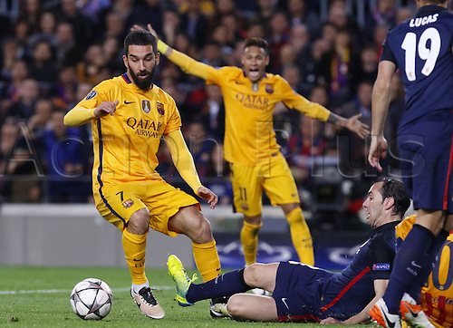 05.04.2016 Nou Camp, Barcelona, Spain. Uefa Champions League Quarter-finals 1st leg. FC Barcelona against Atletico de Madrid.  Arda Turan turns away from the tackle