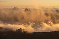 Mistly clouds conceal mountain peaks at dawn, Lofoten Islands, Norway