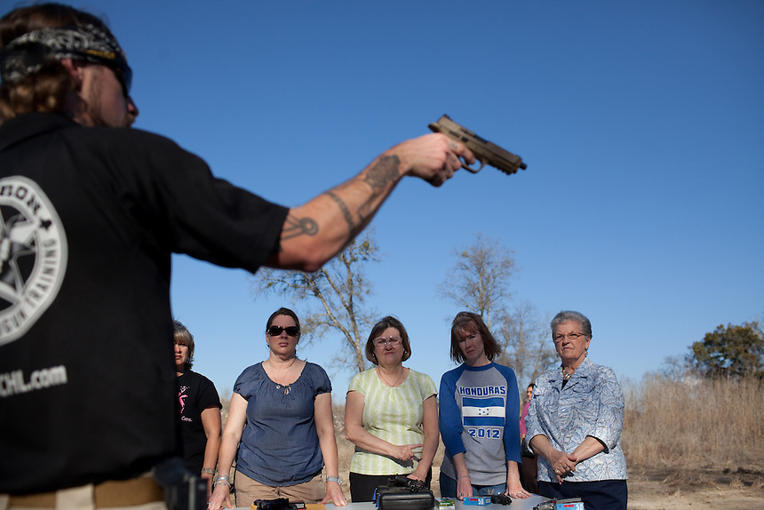 Luke Price, foreground, of Big Iron, trains teachers and staff of Clifton Independent School District in a concealed handgun class near Clifton, Texas. L to R: Brenda Finstad, Clifton High School english teacher; Julie Davis, special education aid at Clifton Elementary School; Sheila Musselman, Clifton Elementary School computer lab; Amy Crabtree, pre-K at Clifton Elementary School; and Carolyn Billington, receptionist at Clifton Elementary School. February 7, 2013. CREDIT: Lance Rosenfield/Prime