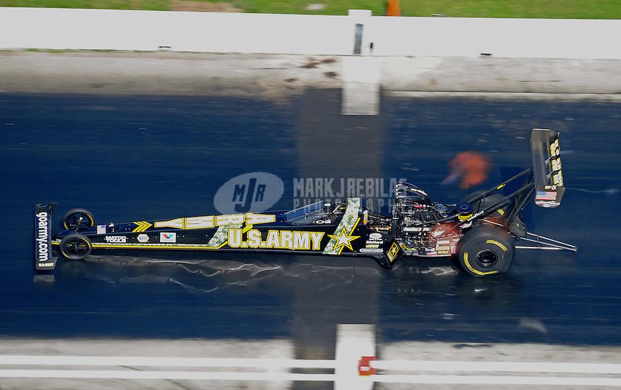 Apr. 28, 2012; Baytown, TX, USA: NHRA top fuel dragster driver Tony Schumacher during qualifying for the Spring Nationals at Royal Purple Raceway. Mandatory Credit: Mark J. Rebilas-