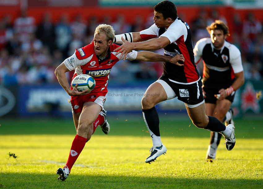 Photo: Richard Lane/Richard Lane Photography. Gloucester Rugby v Biarittz. Heineken Cup. 11/10/2008. Gloucster's Olly Morgan is tackled by Biarittz' Damien Traille.