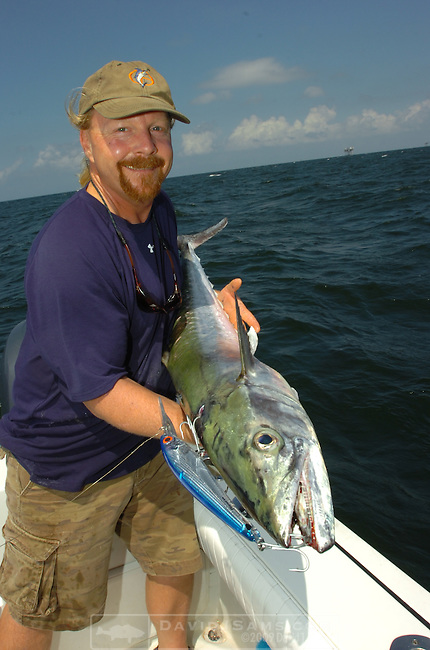 OFFSHORE FISHING.Peace Marvel shows a king mackerel caught on bomber trolling bait est. 35 pounds.near oil production platform...Venice, Louisiana