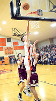 Westside Eagle Observer/MIKE ECKELS<br /> <br /> Lion Tristan Batie (center) puts up a high layup during the Jan. 24 Homecoming basketball contest between the Gravette Lions and Huntsville Eagles in Gravette. Batie was one of two Lions players in double figures with 11 points.