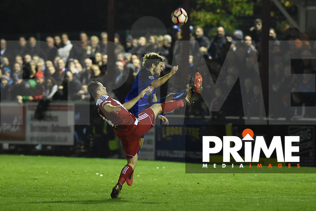 Stourbridge captain Tom Tonks and Whitehawk's captain Sergio Torres challenge for the ball during the FA Cup 1st round replay match between Stourbridge and Whitehawk  at the War Memorial Athletic Ground, Stourbridge, England on 14 November 2016. Photo by Garry Griffiths.