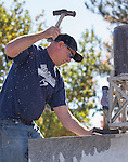 Craig Lemmons competes in the single jack rock drilling contest during the Nevada Day activities in Carson City on Saturday, October 29, 2016.