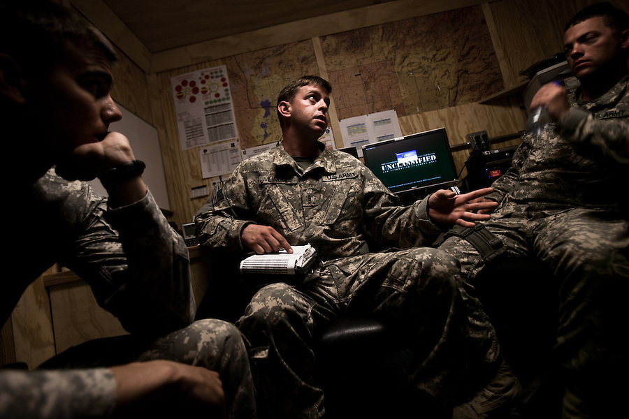 "Pilots and crew members go through a brief - discussing weather, threats, procedures for crash landings... - in Charlie Company headquarters before assuming their duties at the beginning of their shift. Scenes from the medical evacuations of wounded Americans, Canadians, and Afghan civilians and soldiers being flown by Charlie Co. 6th Battalion 101st Aviation Regiment of the 101st Airborne Division. Charlie Co. - which flies under the call-sign ""Shadow Dustoff"" - flies into rush the wounded to medical care out of bases scattered across Oruzgan, Kandahar, and Helmand Provinces in the Afghan south. These images were taken of missions flown out of Kandahar Airfield in Kandahar Province and Camp Dwyer in Helmand Province."