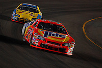 Apr 22, 2006; Phoenix, AZ, USA; Nascar Nextel Cup driver Travis Kvapil of the (32) Tide Dodge Charger leads Bobby Labonte during the Subway Fresh 500 at Phoenix International Raceway. Mandatory Credit: Mark J. Rebilas-US PRESSWIRE Copyright © 2006 Mark J. Rebilas..