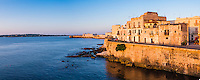 Panoramic photo of Ortigia Old City at sunrise, with Ortigia Castle (Castello Maniace, Castle Maniace) in the background, Syracuse (Siracusa), UNESCO World Heritage Site, Sicily, Italy, Europe. This is a panoramic photo of Ortigia Old City at sunrise, with Ortigia Castle (Castello Maniace, Castle Maniace) in the background, Syracuse (Siracusa), UNESCO World Heritage Site, Sicily, Italy, Europe.