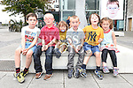 Oisín Brophy pictured with his cousins at the official launch of the Down Syndrome Photo exhibition at Scotch Hall. Photo:Colin Bell/pressphotos.ie