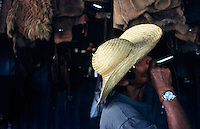 A cowboy, or gaucho, takes a smoke in the tack barn on the Fazenda Rio Negro in Brazil's giant Pantanal Mato Grossense wetland. The wetland, half the size of France, supports one of the most intact arrays of wildlife in the world, despite 200 years of cattle ranching. Subdivision of properties in the region weaken the economic viability of the traditional ranches.