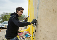 NWA Democrat-Gazette/BEN GOFF @NWABENGOFF<br /> Rich Simmons of London, England, works on his mural Thursday, April 11, 2019, on the side of the Old Ice House building on South Arkansas Street in downtown Rogers. The mural is a partnership between the city of Rogers, Crystal Bridges Museum of American Art and the Walton Family Foundation. Simmons expects to complete the four-story tall mural early next week.