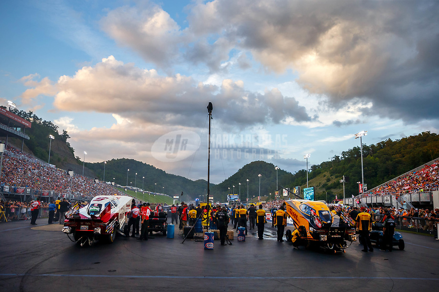 Jun 16, 2017; Bristol, TN, USA; Overall view of Bristol Dragway as crew members for NHRA funny car driver Cruz Pedregon (left) and J.R. Todd prepare to fire the cars up during qualifying for the Thunder Valley Nationals at Bristol Dragway. Mandatory Credit: Mark J. Rebilas-USA TODAY Sports
