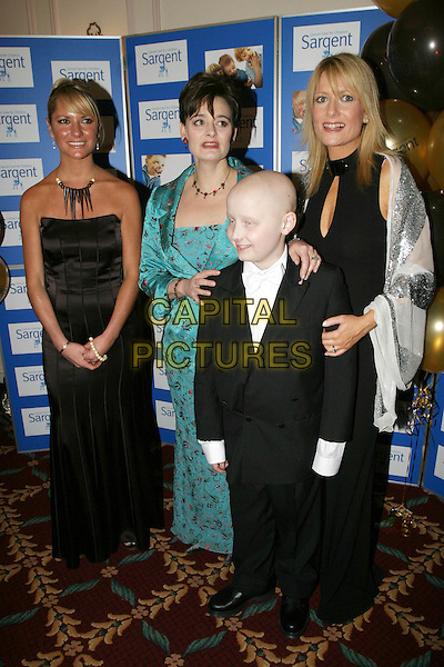 ALEX BEST, CHERIE BLAIR & GABBY ROSLIN.The Chocolate Ball in aid of sargent Cancer Care for Children at the Cafe Royal, Picadilly.11 March 2004.full length, full-length, turquoise.www.capitalpictures.com.sales@capitalpictures.com.©Capital Pictures