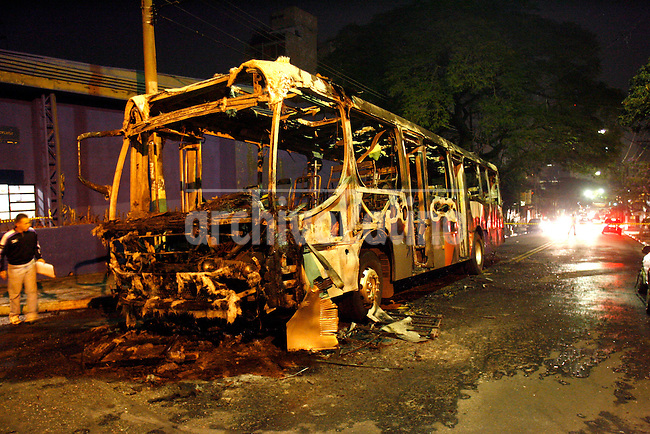 A burned bus is seen during the dawn hours of Thursday,July 13, 2006 in Sao Paulo, Brazil. .Photo: Andre Penner