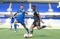 Viv Solomon-Otabor, Wigan Athletic,  prepares to cross under pressure from Luke Chambers of Ipswich Town during Ipswich Town vs Wigan Athletic, Sky Bet EFL League 1 Football at Portman Road on 13th September 2020