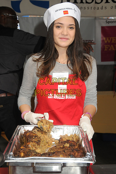 25 November 2015 - Los Angeles, California - Luna Blaise. 2015 Los Angeles Mission Thanksgiving Meal for the Homeless held at the LA Mission. <br /> CAP/ADM/BP<br /> &copy;BP/ADM/Capital Pictures
