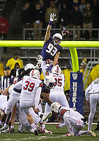 Connor Griffin leaps in a failed attempt to block a field goal.