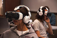 Mia D'Orazio (sister of Oxy student Savannah D'Orazio) and Logan Justice try out the Oculus Rift virtual reality headset on February 15, 2016 in Brown Lab. Event organized by student Drake Tien. As part of UN week, students watch selected short films about a young Syrian refugee or the Ebola virus aftermathin Liberia. (Photo by Nick Harrington, Occidental College Class of 2017)