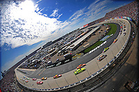 Sept. 21, 2008; Dover, DE, USA; Nascar Sprint Cup Series drivers go through turn one during the Camping World RV 400 at Dover International Speedway. Mandatory Credit: Mark J. Rebilas-