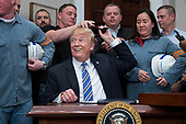 US President Donald J. Trump (C) hands out pens to workers while signing a presidential proclamation on steel and aluminum tariffs, in the Roosevelt Room of the White House in Washington, DC, USA, 08 March 2018. President Trump is imposing tariffs on steel and aluminum imports. A decision to impose the tariffs on Canada or Mexico will not be decided until negotiations on the North American Free Trade Agreement (NAFTA).<br /> Credit: Michael Reynolds / Pool via CNP