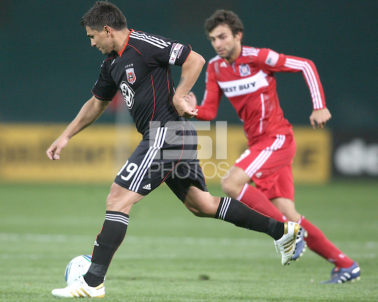 Jaime Moreno #99 of D.C. United moves past Baggio Husdic #9 of the Chicago Fire during an MLS match on April 17 2010, at RFK Stadium in Washington D.C. Fire won the match 2-0.